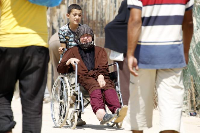 Des réfugiés syriens, dans le camp de Mafraq, en Jordanie, le 1er septembre.