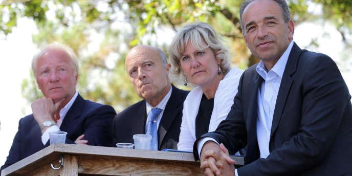 Les membres de l'UMP, Brice Hortefeux, Alain Juppé, Nadine Morano et Jean-Francois Copé lors d'un meeting des