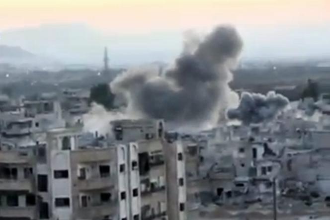 Bombardements à Barza aux abords de Damas, le 10 septembre 2013.