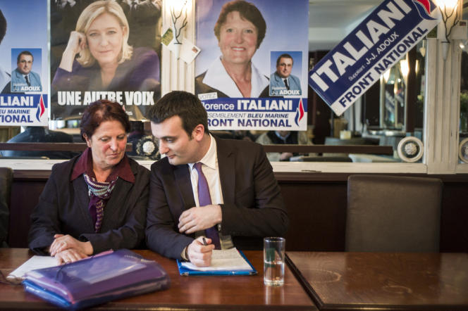 Le vice-président du Front national Florian Philippot et la candidate du parti pour la législative partielle dans l'Oise, Florence Italiani, dans un bar de Beauvais le 21 mars 2013.
