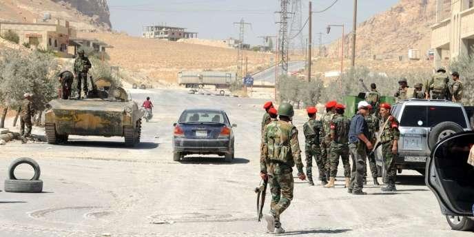 Des soldats de l'armée syrienne dans la ville de Maalula le 7 septembre.