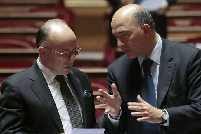 Bernard Cazeneuve, ministre du budget, et Pierre Moscovici, ministre de l'économie et des finances, au Sénat, le 19 septembre.