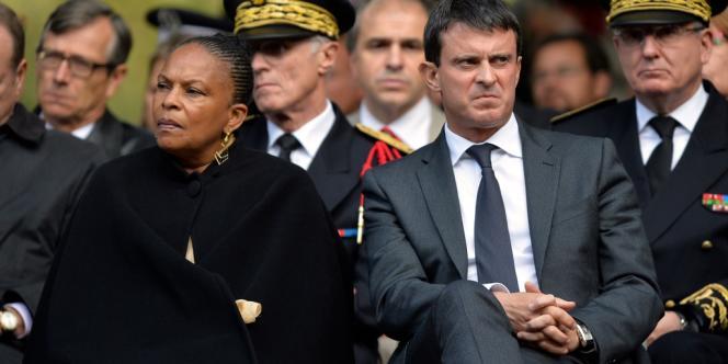 Christiane Taubira et Manuel Valls lors d'une cérémonie à la mémoire des victimes du terrorisme, le 19 septembre 2013 aux Invalides.