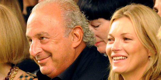 Kate Moss et Sir Philip Green, le président directeur général du groupe Aracadia, propriétaire de Topshop, lors du défilé de la marque à Londres, le 15 septembre 2013.