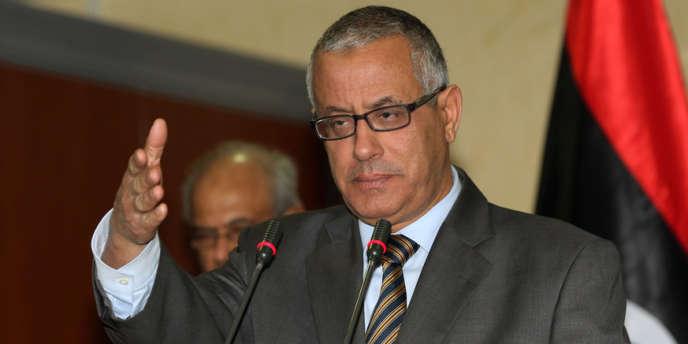 Ali Zeidan a été libéré par ses ravisseurs, quelques heures après avoir été enlevé en représailles à la capture d'un haut responsable d'Al-Qaida par les Etats-Unis – ici M. Zaidan lors d'une conférence de presse à Tripoli, en février.