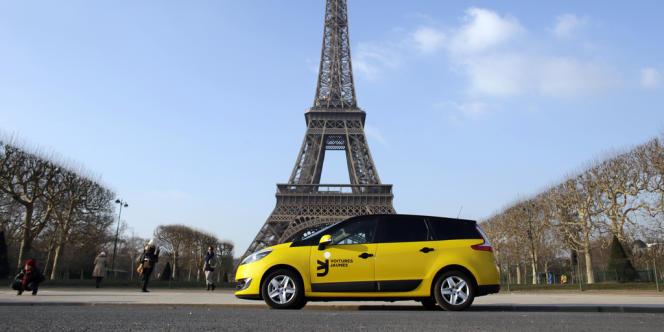 Un véhicule de la compagnie Voitures jaunes, en janvier 2013.