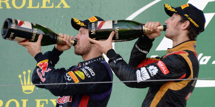 Sebastian Vettel et Romain Grosjean, sur le podium du Grand Prix de Suzuka, le 13 octobre.