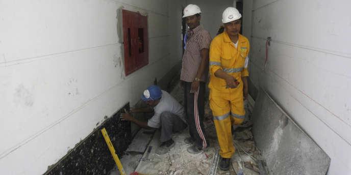 Des travailleurs sur un chantier de Doha, le 18juin2012.