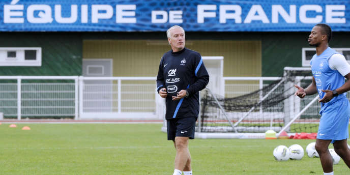 Didier Deschamps et Patrice Evra, en août 2012 à Clairefontaine.