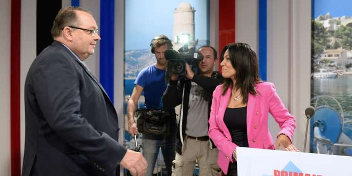 Patrick Mennucci et Samia Ghali, les candidats à la primaire socialiste pour les municipales de 2014 à Marseille, jeudi 17 octobre, lors d'un débat télévisé.