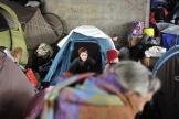 Des demandeurs d'asile albanais sous un pont à Lyon, en 2013.