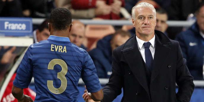 Patrice Evra a été blanchi par son sélectionneur Didier Deschamps (à droite) et le président de la Fédération française de football, Noël Le Graët.