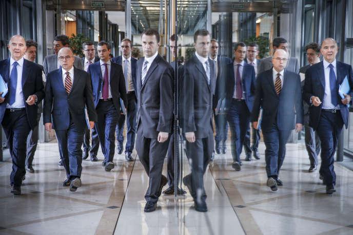 Pierre Moscovici, ministre de l'économie, et Bernard Cazeneuve, ministre délégué au budget, à Bercy mercredi 11 septembre 2013.
