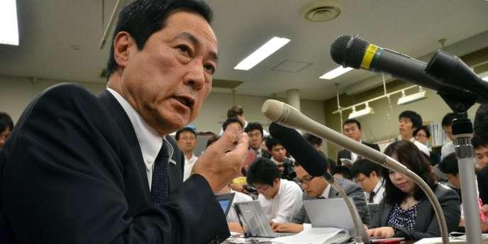 Yasuhiro Sato, le patron du Mizuho, l'établissement par lequel le scandale a éclaté, fin septembre. M. Sato a dû admettre avoir été « en position » de connaître le problème dès juillet 2011.
