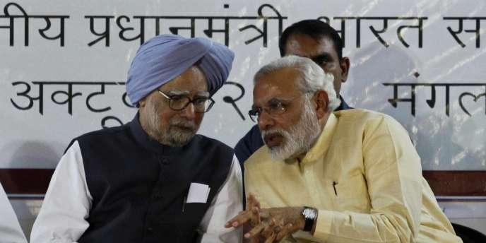 Le premier ministre indien, Manmohan Singh (à gauche), et le nationaliste Narendra Modi, candidat de l'opposition pour les élections de 2014.
