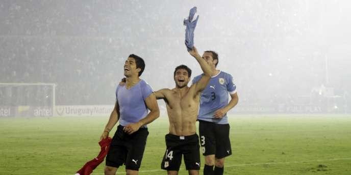 Luis Suarez (à gauche), Nicolas Lodiero (au centre) et Diego Godin (à droite) seront au Brésil cet été.