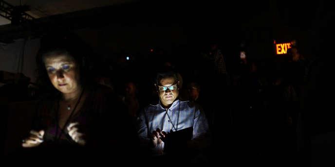 Des journalistes écrivent sur leur tablette, à New York, le 23 septembre. Actuellement, les