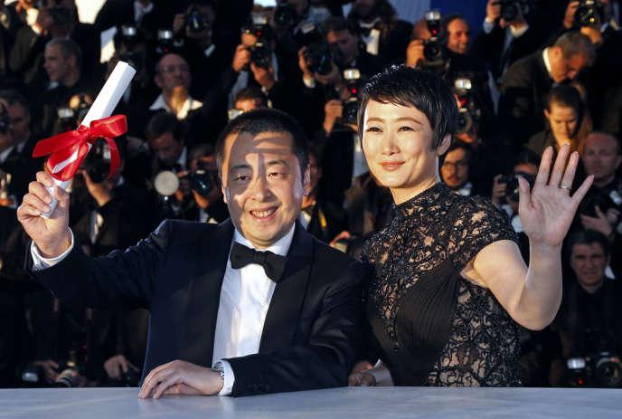 Le réalisateur chinois Jia Zhangke et l'actrice Zhao Tao lors de la cérémonie de clôture du 66e Festival du film de Cannes, le 26 mai 2013.