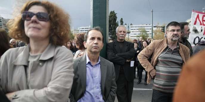 Manifestation contre l'austérité le 26 novembre, à Athènes. Un changement de la loi risquerait de jeter à la rue 150 000 personnes.
