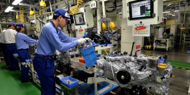 Dans une usine d'assemblage automobile de la marque Subaru, à Oizumi, au nord de Tokyo, en septembre.