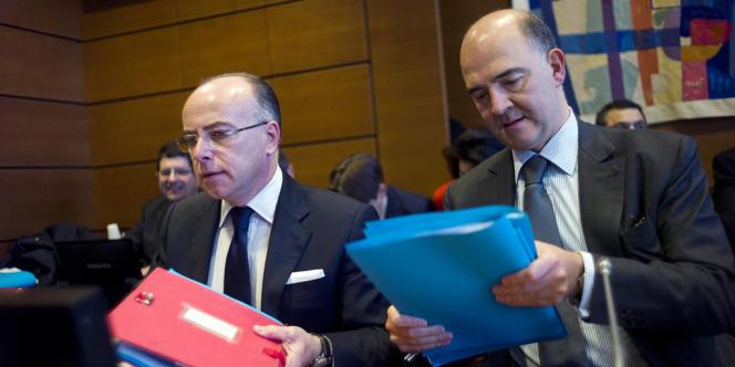 Bernard Cazeneuve, le ministre du budget, et Pierre Moscovici, le ministre de l'économie, le 13 novembre 2013, à l'Assemblée nationale.