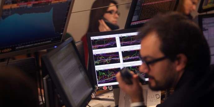 Des analystes financiers, le 9 janvier à Lisbonne.