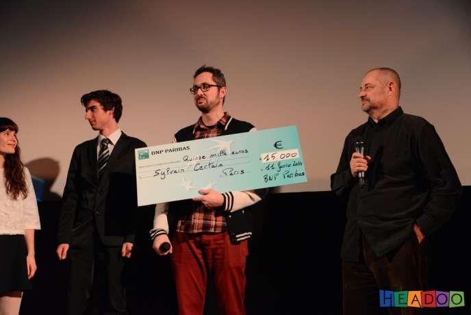 De gauche à droite : Lou Tilly, Maxime Dejent, Sylvain Certain et Jean-Pierre Jeunet, président du jury, lors de la cérémonie de clôture du Mobile Film Festival 2014 à Paris, le 11 février.