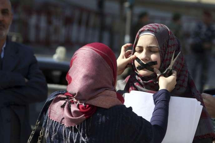 Beyrouth, le 8 février. Manifestation de soutien aux journalistes d'Al-Jazira détenus en Egypte.