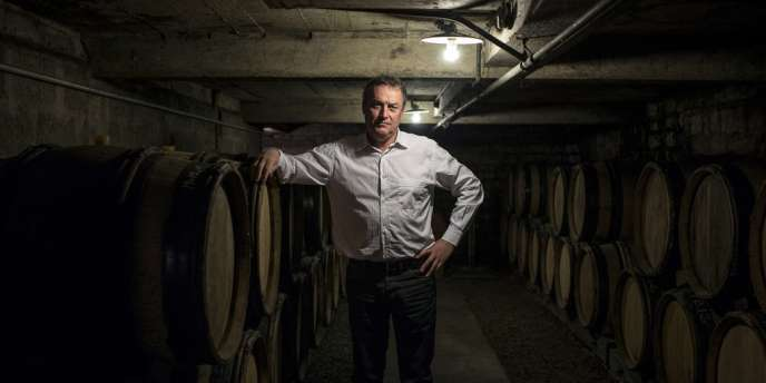 French winemaker Emmanuel Giboulot, poses in his domain's wine cellar, on February 24, 2014 in Beaune. Giboulot is being pursued by an arm of the agriculture ministry for not heeding a local directive in Burgundy's wine-growing Cote d'Or area to regularly treat vines against a leaf-hopping insect that causes an infectious disease called