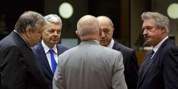 Les ministres des affaires étrangères grec, belge, hongrois et luxembourgeois avec leur homologue français Laurent Fabius, lundi 3 mars à Bruxelles.