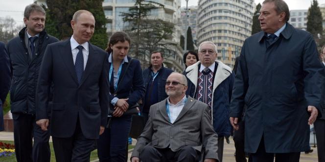Le président russe Vladimir Poutine en compagnie du président des jeux Paralympiques d'hiver, Philip Craven, vendredi 7 mars avant la cérémonie d'ouverture.