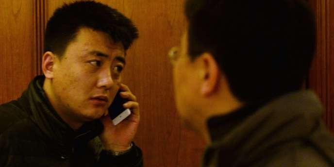 Un proche d'un passager du vol MH370 de la Malaysia Airlines, le 11mars à Pékin.