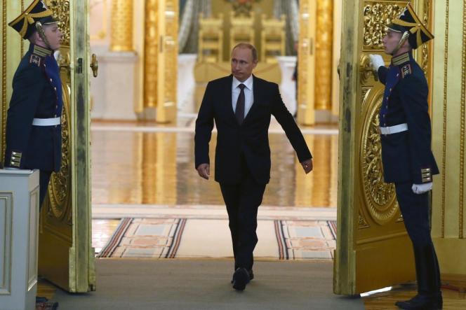Vladimir Poutine arrive pour s'adresser à la Douma sur le référendum en Crimée, le 18 mars à Moscou.