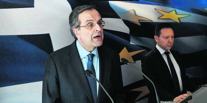 Le chef du gouvernement grec, Antonis Samaras, et le ministre des finances, Yannis Stournaras, mardi 18 mars, à Athènes.