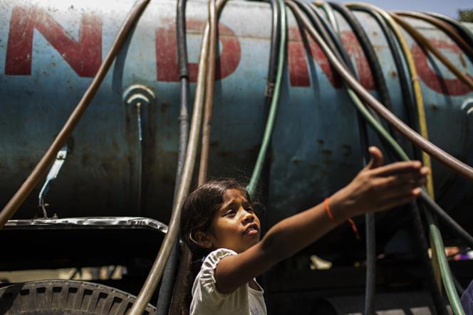 Camion-citerne fourni par le gouvernement indien lors d'un épisode de sécheresse à New Delhi en mai 2013.