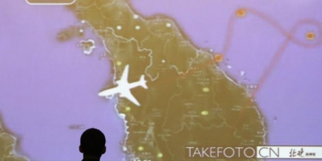 Réunion d'information des familles des passagers du vol MH370 à Pékin, le 22 mars.