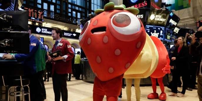 Des personnages du jeux sur mobiles Candy Crush, défilent à la bourse de New York, le 26 mars, jour de l'introduction en bourse de King Digital Entertainment, l'éditeur du jeux.