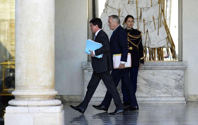 Manuel Valls et Jean-Marc Ayrault, à l'Elysée, le 12 mars.