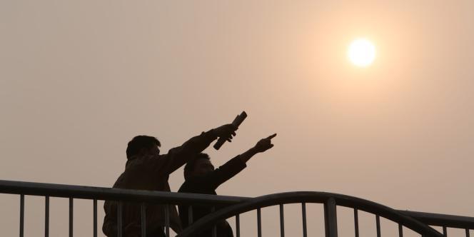 Lors d'une alerte à la pollution à Pékin, en Chine, en mars.