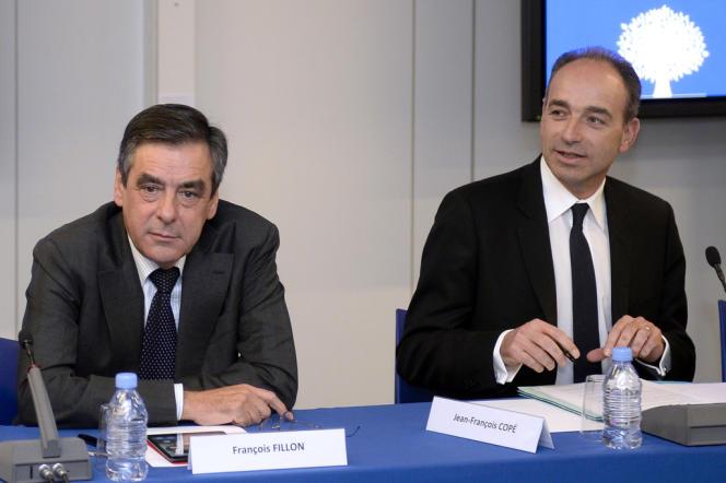 François Fillon et Jean-François Copé au siège de l'UMP, le 18 décembre 2013.