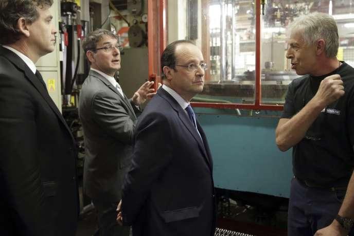 François Hollande et le ministre de l'économie, Arnaud Montebourg, en visite à Clermont-Ferrand, le 18 avril.
