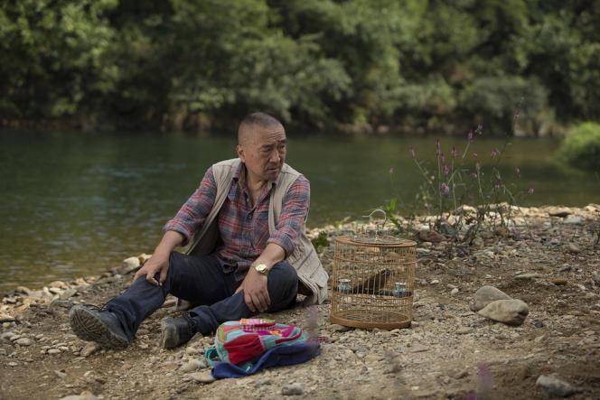 Baotian Li dans le film chinois et français de Philippe Muyl, « Le Promeneur d'oiseau ».