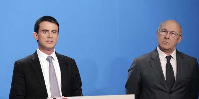 Le premier ministre Manuel Valls dévoile son plan d'économies de 50 milliards aux cotés du ministre des finances Michel Sapin.
