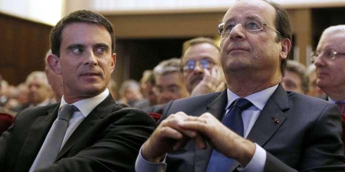 Manuel Valls et François Hollande, le 28 avril 2014 à Paris.