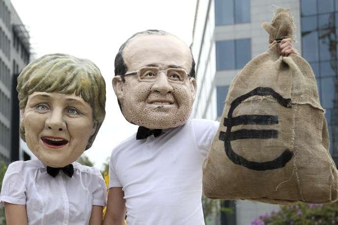 Des manifestants à Bruxelles le 6 mai. Ils demandent la mise en œuvre de la taxe sur les transactions financières pour combattre la pauvreté.