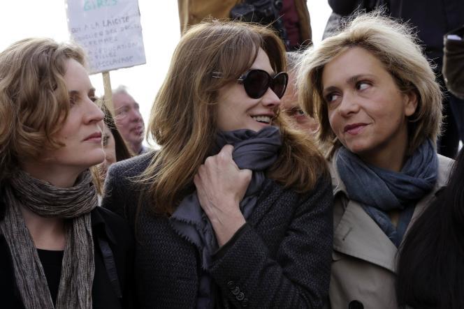 Nathalie Kosciusko-Morizet, Carla Bruni-Sarkozy et Valérie Pecresse, le 13 mai à Paris.