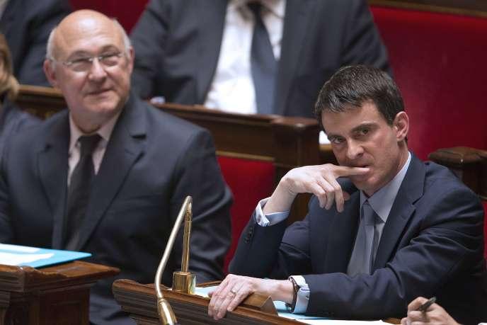 Manuel Valls et Michel Sapin, à l'Assemblée nationale le 13 mai 2014.