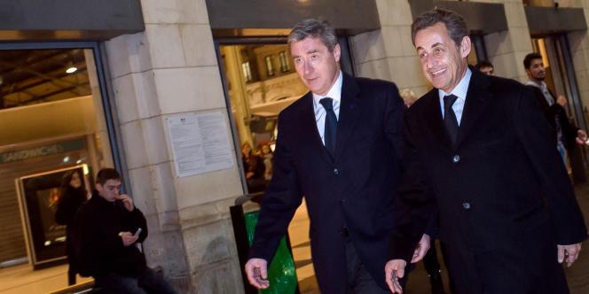Le trésorier de la campagne présidentielle de 2012, Philippe Briand, et Nicolas Sarkozy, le 17 décembre 2013, à Tours.