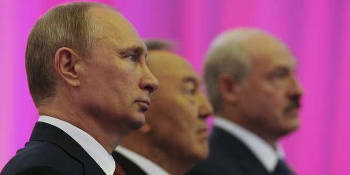 Vladimir Poutine, Noursoultan Nazarbaïev et Alexandre Loukachenko, à Astana, le29mai2014.