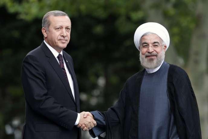 Le président Rohani (à droite), aux côtés de Recep Tayyip Erdogan à Ankara le 9 juin.